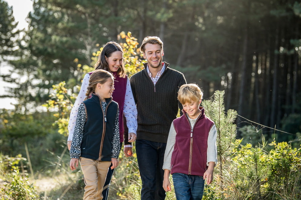 Schoffel family walking wearing schoffel gilets gilanders town and country