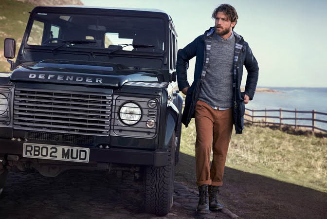 Barbour jackets man walks by landrover in barbour clothes - gillanders town and country